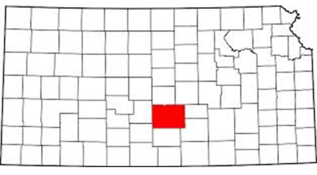 A volunteer Reno County firefighter is charged with 14 felony counts of arson after investigators alleged he set more than a dozen grass fires last fall.