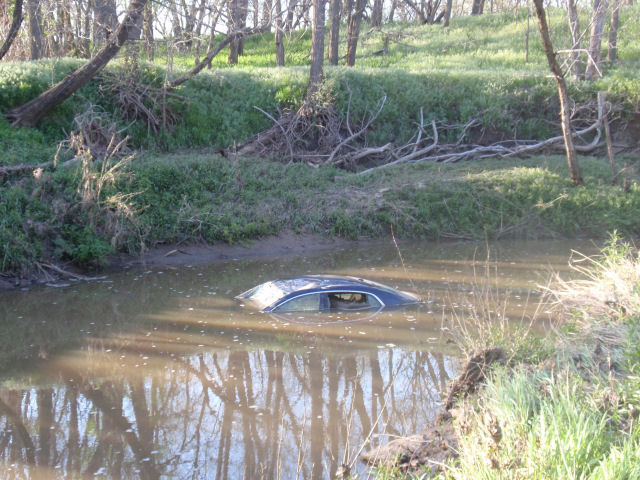 The car was washed away in flooding late Wednesday night.