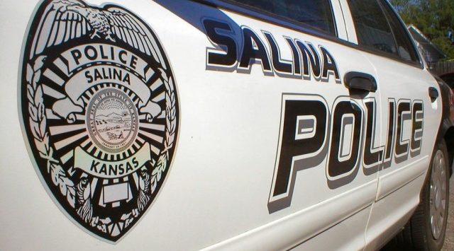 A Salina woman is injured after leaping from a moving car.