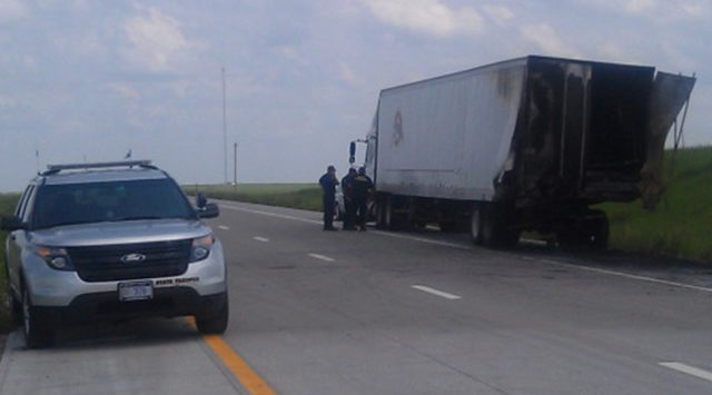 Troopers say the eastbound SUV drove onto the shoulder and hit the trailer from behind. (KSN News Photo)