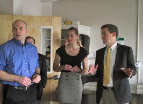 Governor Sam Brownback talks with students Jeff Horinek and JuliAnne Rathbaun while touring the University of Kansas School of Medicine's Salina campus.