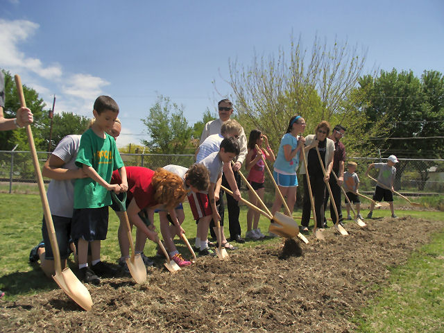 Students break ground Wednesday.