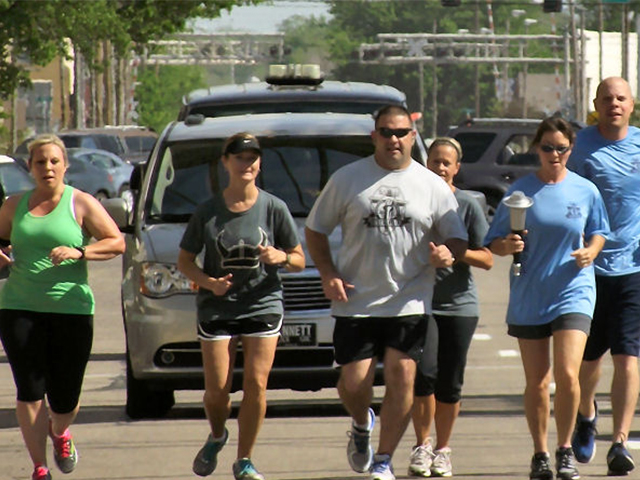 A torch that will ultimately end up at the Special Olympics games in Wichita was carried through the streets of Salina on Wednesday.
