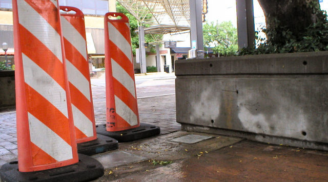 Two Campbell Plaza junction boxes are located near the sidewalk on S. Santa Fe Avenue.