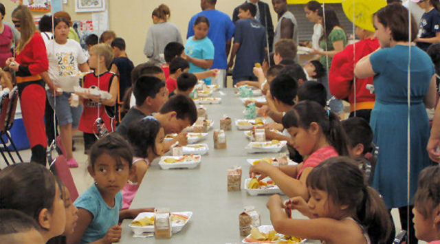 The free lunches are for all children ages one through eighteen. Adults are welcome to eat for $3.50.