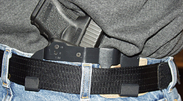 A law taking effect Monday allows people with concealed-carry permits to bring their guns into public buildings.