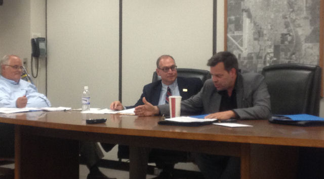 Salina City Commissioner Aaron Householter (right) debates with Saline County Commissioner John Price (left).