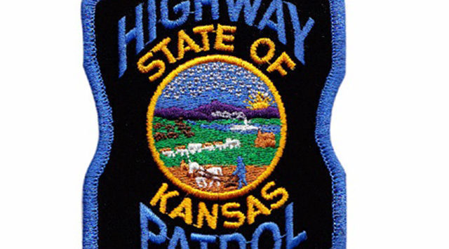Two people are hurt when a car strikes a truck that was protecting a crew working along Interstate 70 Monday evening.