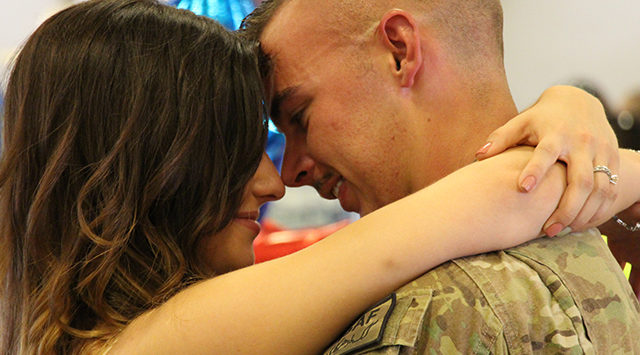 Returning soldier, Samuel Michael and fiance Olivia embraced for the first time in nine months.