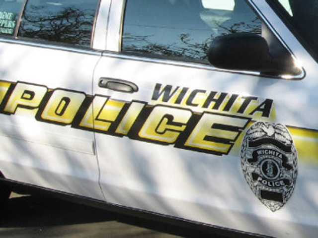 Car Lands in Arkansas River in South Wichita