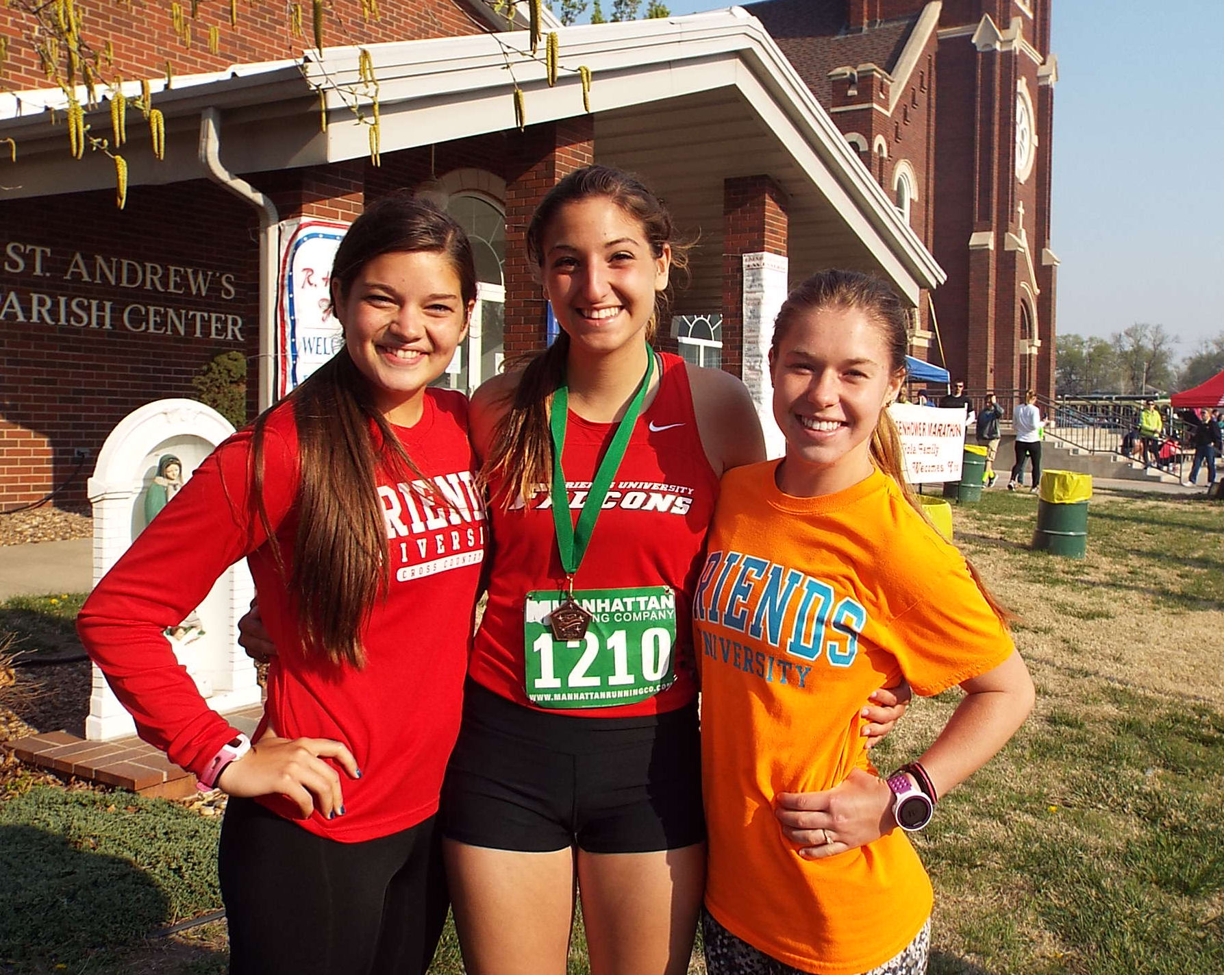 Women's half-marathon winner Sydney Roy's teammates supported her along the way.