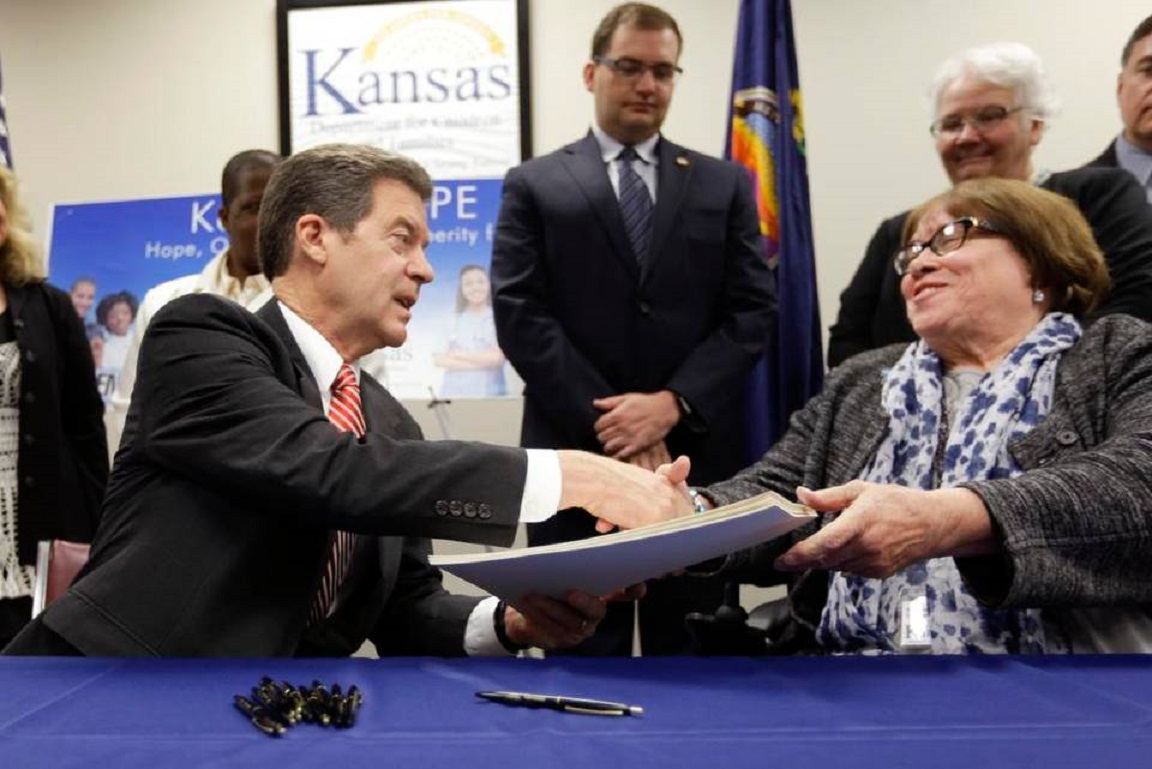 Woman touted as welfare reform success works for state