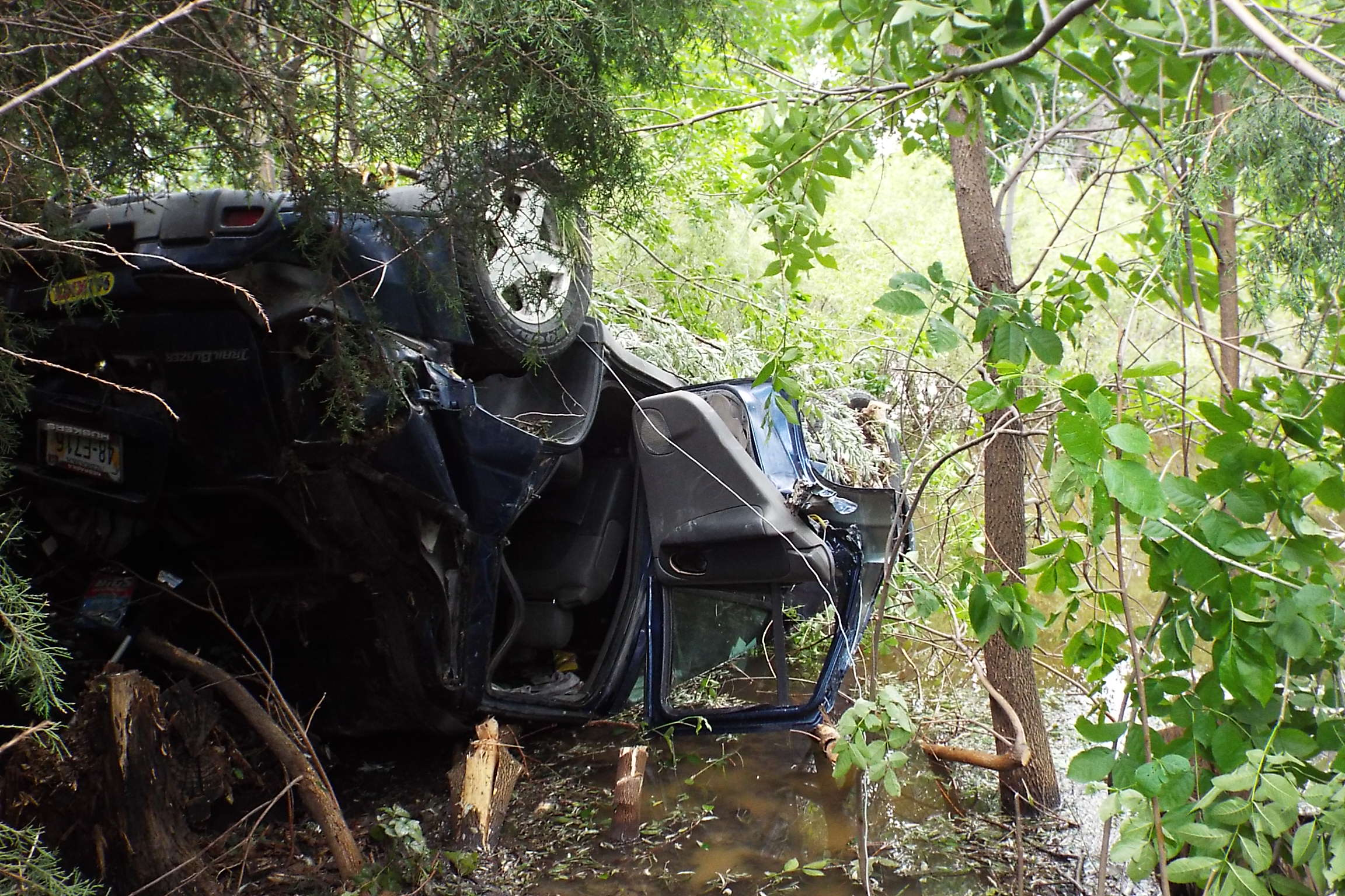 SUV Crashes Into Water In Ditch