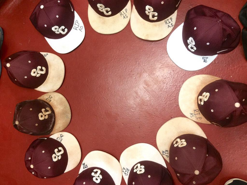The Salina Central baseball team had planned to dedicate its game Thursday to Allie's memory, and added her initials to their caps.