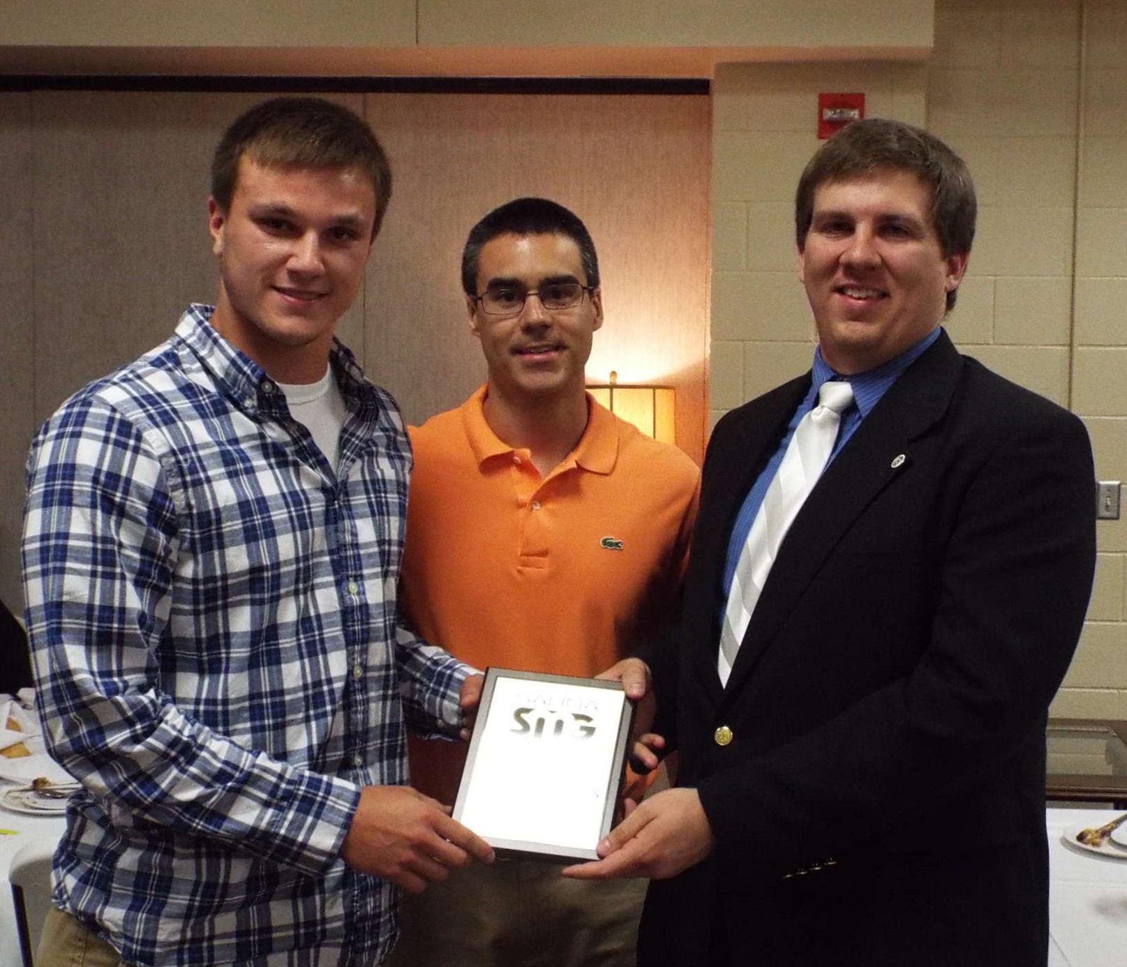 Abilene scholarship winner Tanner Hoekman, KABI's Trent Sanchez, and KSAL's Mike Hammett.