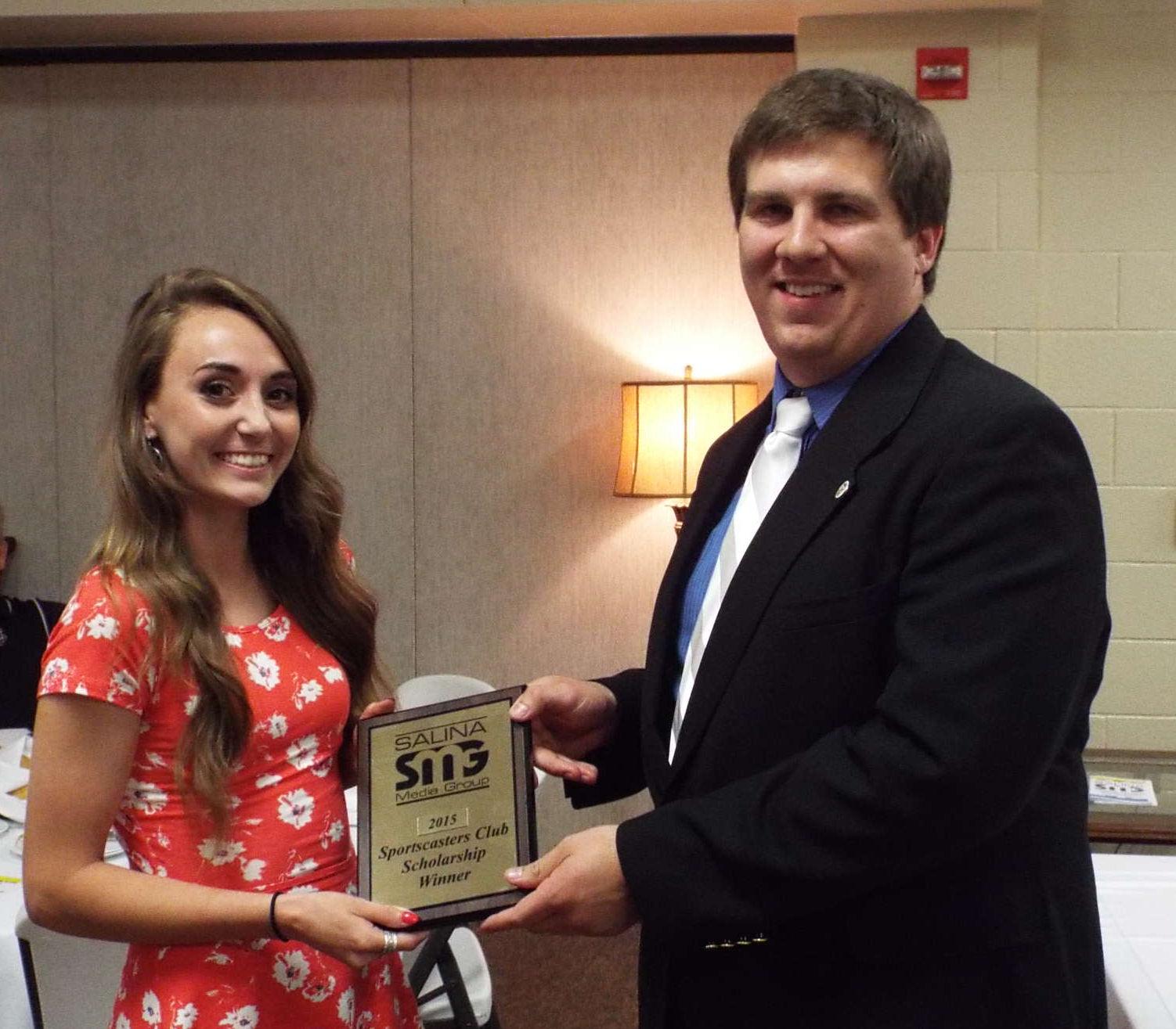 Ell-Saline scholarship winner Emma Drees and KSAL's Mike Hammett.