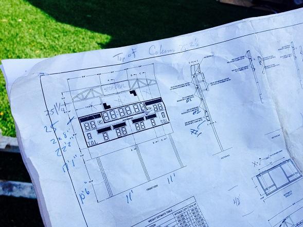 Richard Koetting looks over the blueprints