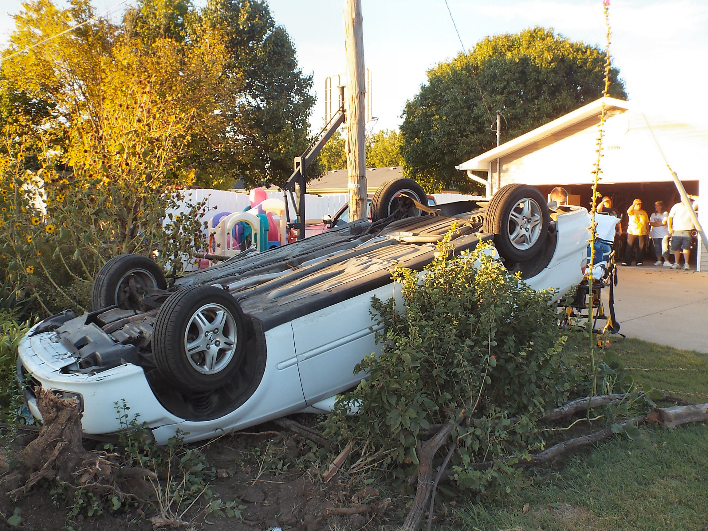 Car Flips Into South Salina Backyard.