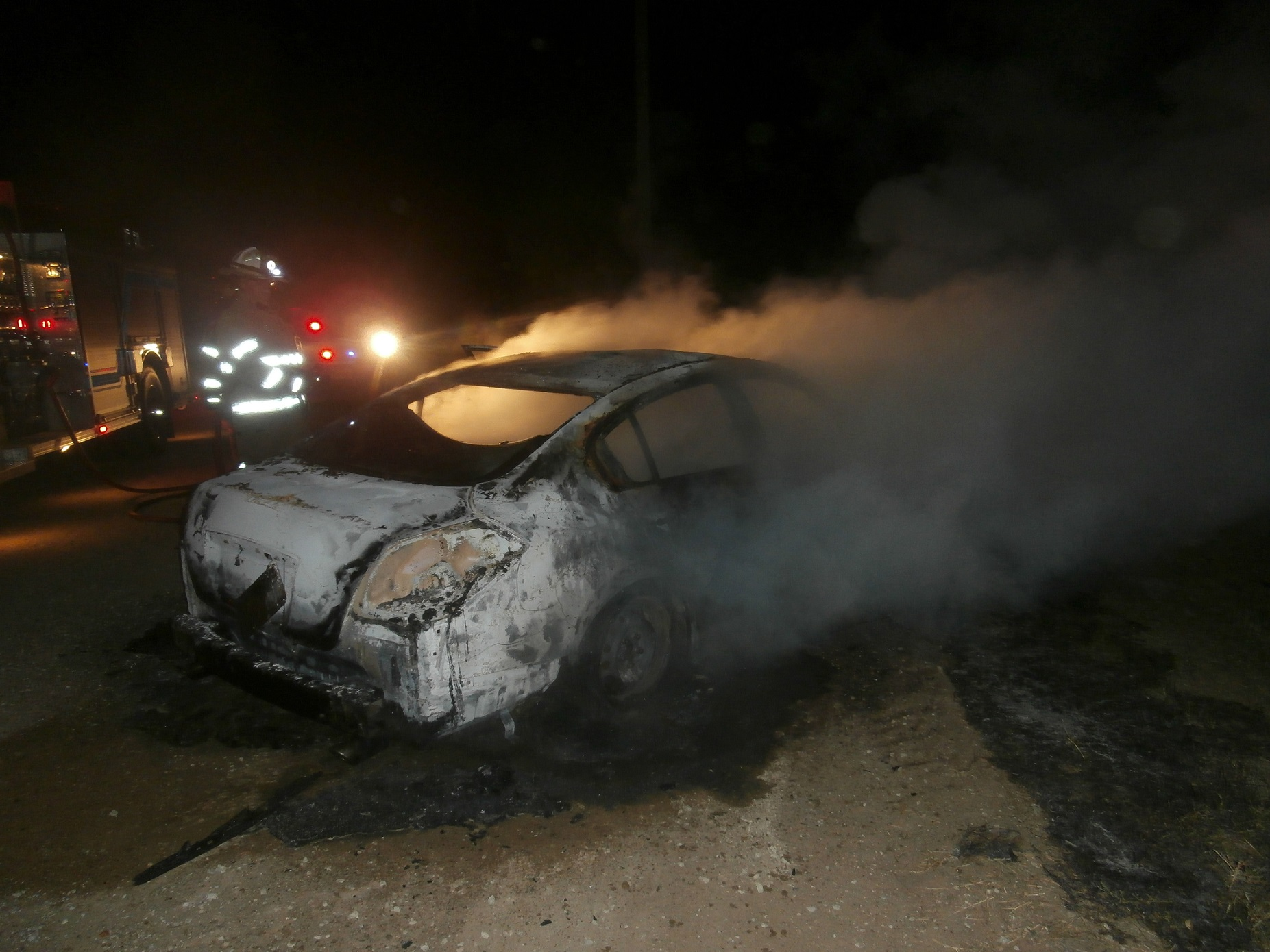 Arson Suspected with Car Theft
