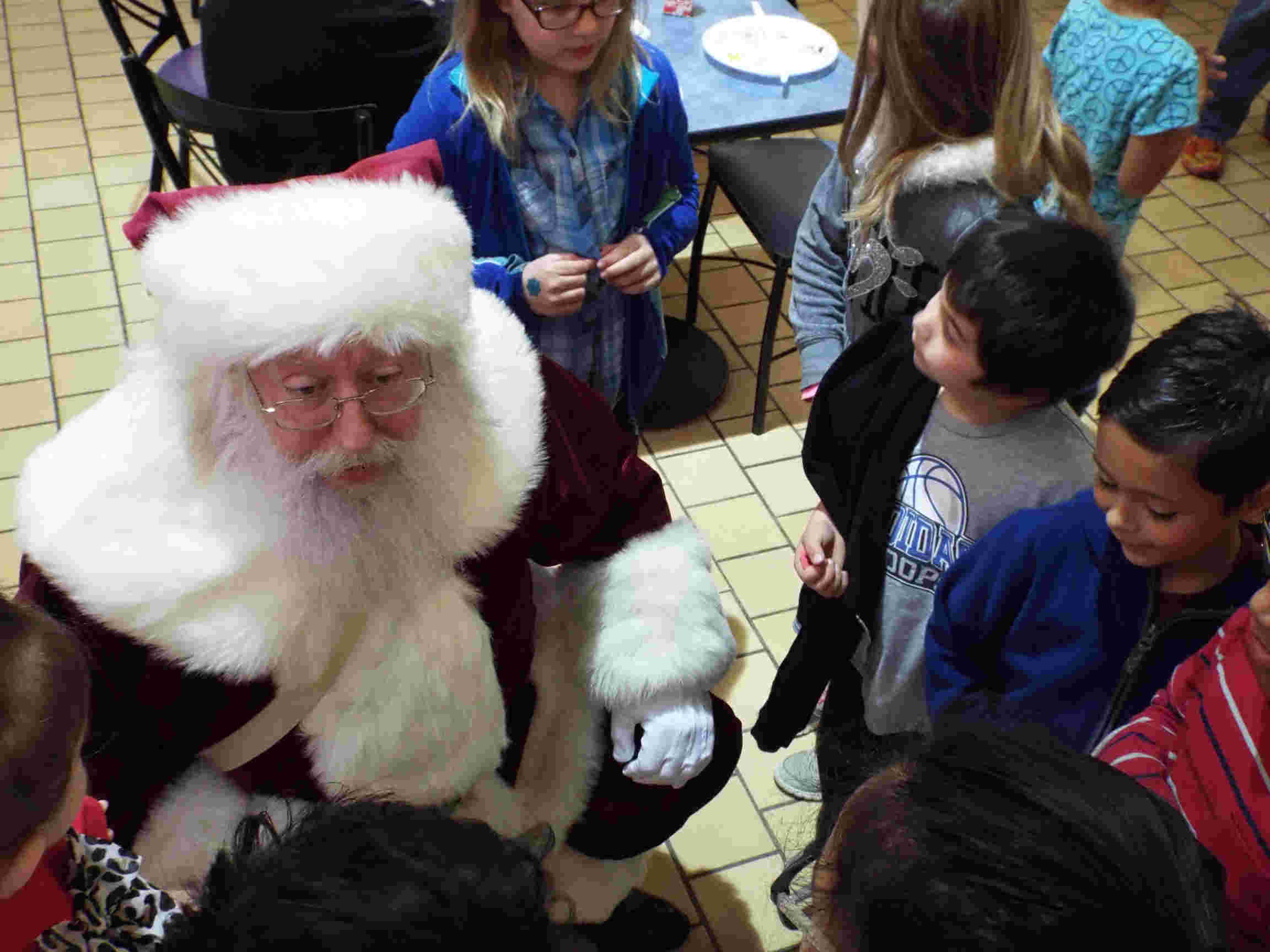 Santa talks with children at the Breakfast With Santa event.