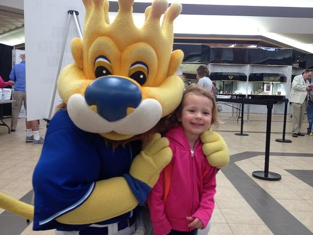 Sluggerrr and 4-year-old Olivia Vosburg of Abilene share a hug on Tuesday