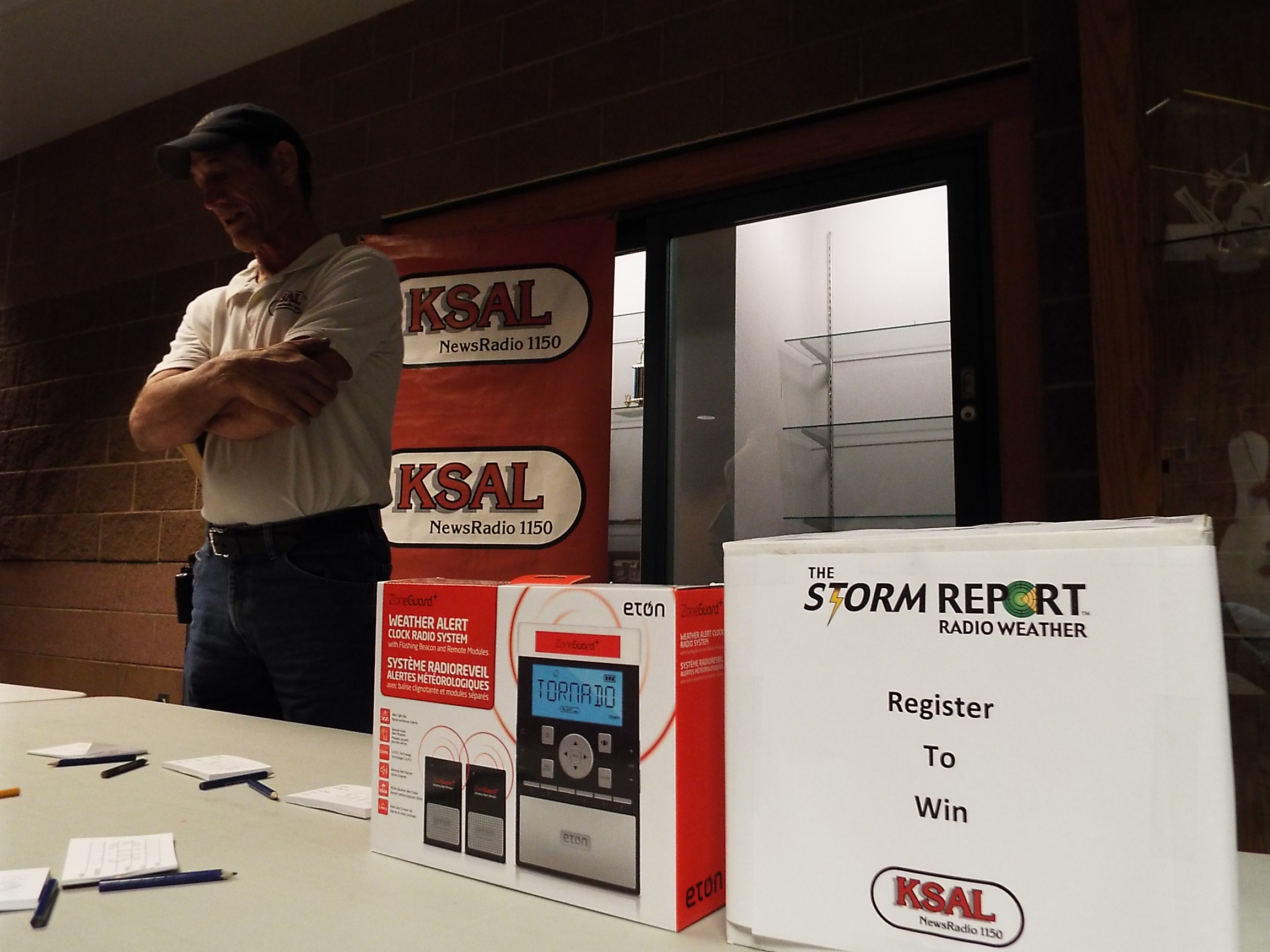 KSAL Storm Chaser Henry Diehl registers people to win a weather radio.