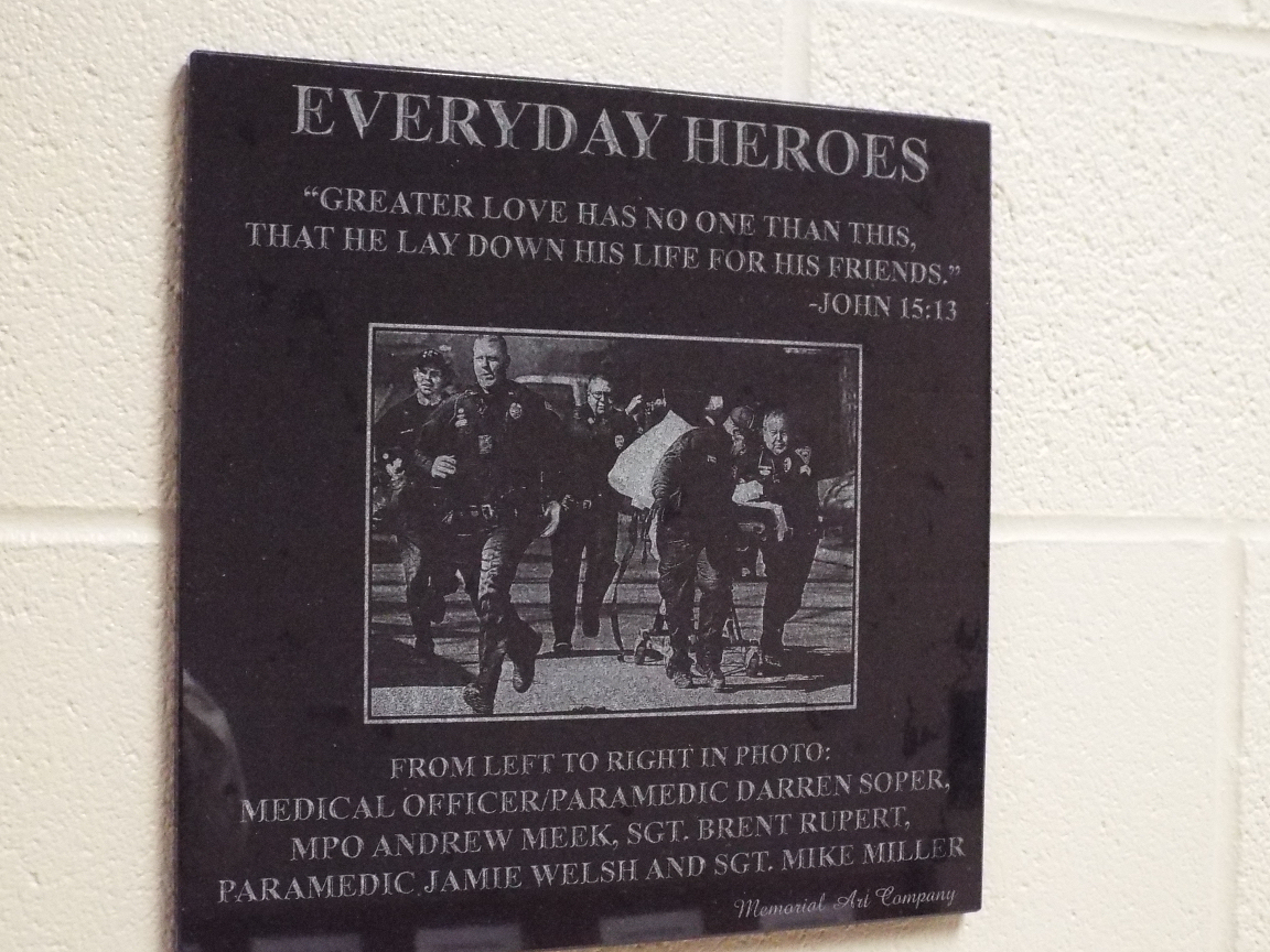 This plaque, made from a photo shot by Tom Dorsey from the Salina Journal, is part of the memorial.
