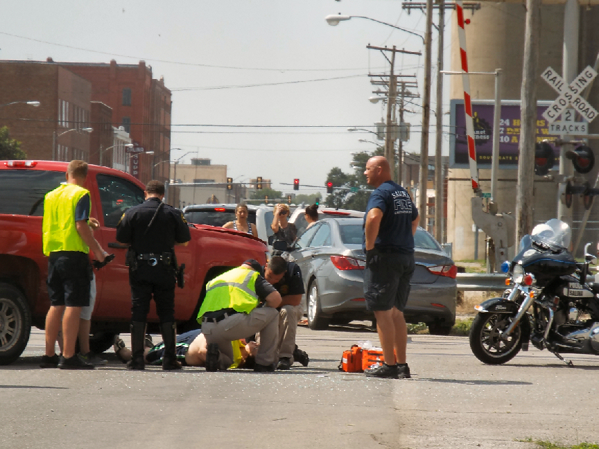 First responders aid the victim as they wait for an ambulance to arrive.