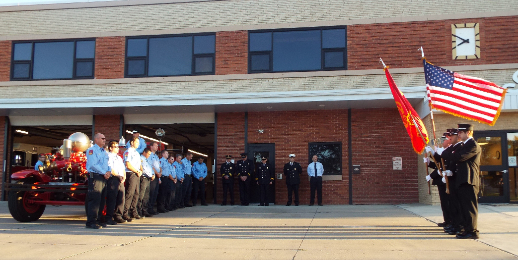 Firefighters observe a moment of silence.