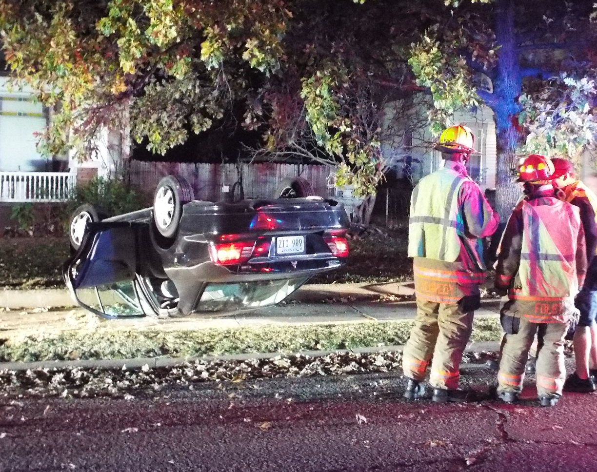Car Flips Into Front Yard