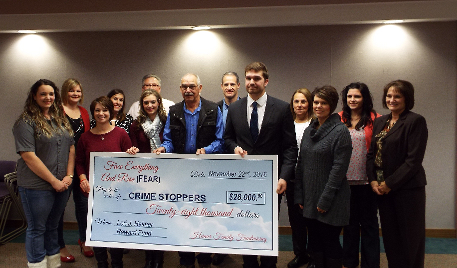 The Heimer family, with the Salina Crime Stoppers Board.