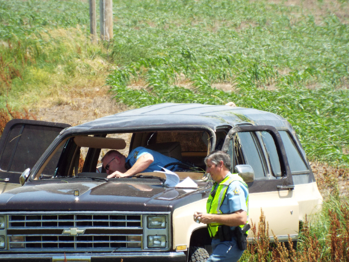 SUV Flips Into Field